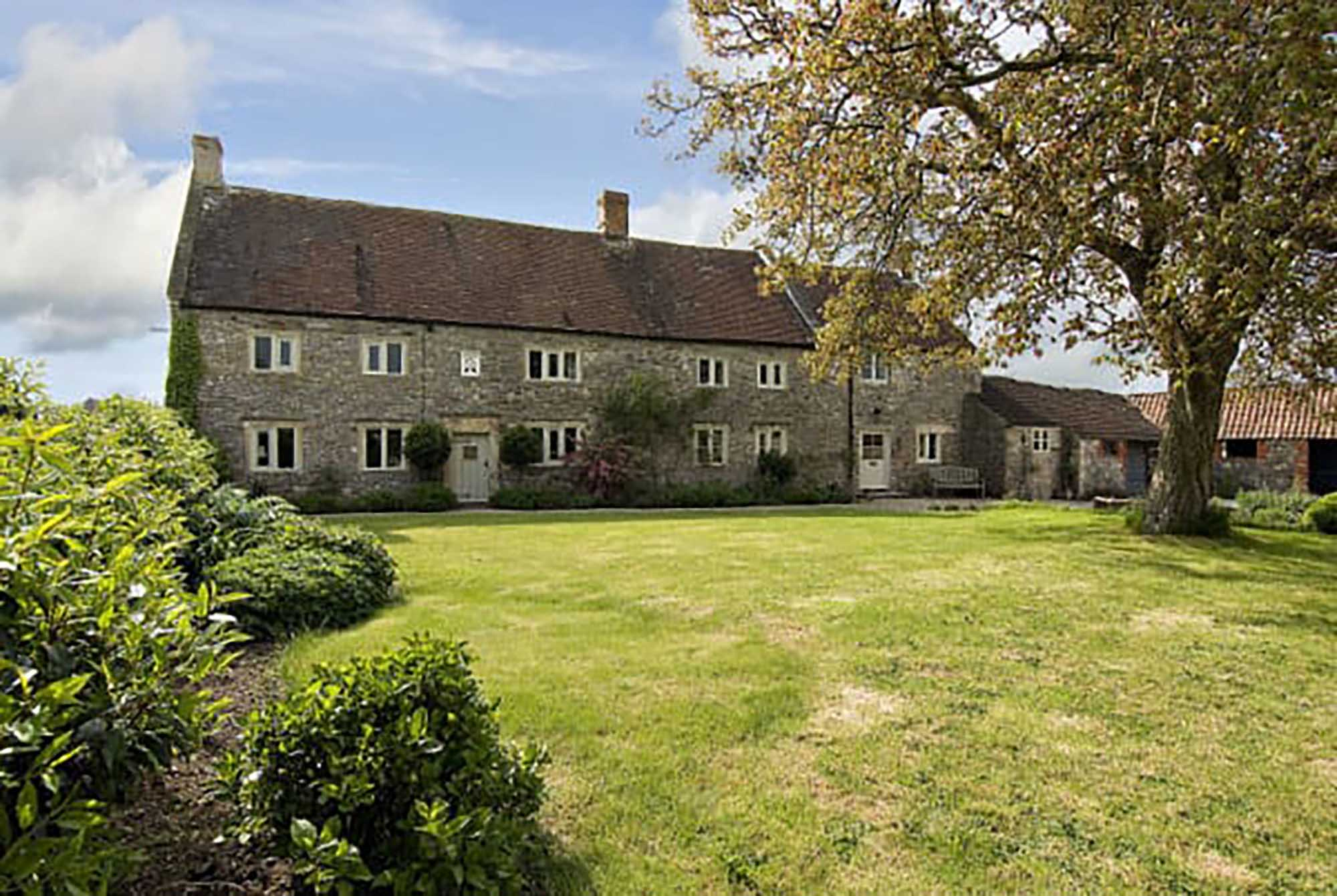 Detached 5 bed house with large stone outbuildings and land